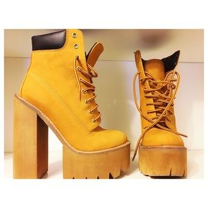 Jeffrey Campbell lace up boots.